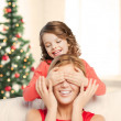 Stockfoto: Mother and daughter making joke