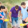 Group of friends having picnic on the beach — Stock Photo