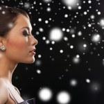 Woman in evening dress wearing diamond earrings — Stock Photo #32677235