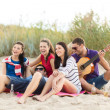 Group of friends having fun on the beach — Stock Photo #32677799