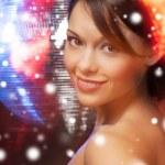 Woman in evening dress wearing diamond earrings — Stock Photo #32677911