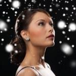Woman in evening dress wearing diamond earrings — Stock Photo #32678385