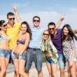 Group of friends having fun on the beach — Stockfoto #32678425