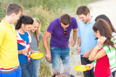 Group of friends having picnic on the beach — Стоковое фото