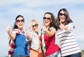 Teenage girls or young women showing thumbs up — Foto de Stock