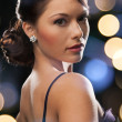 Woman in evening dress wearing diamond earrings — Foto Stock
