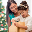 Happy mother and child girl with gift box — Stock Photo #32835297