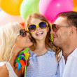 Family with colorful balloons — Foto de stock #32839285
