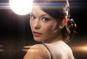 Woman in evening dress wearing diamond earrings — Stock Photo