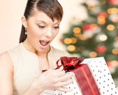 Happy woman with gift box — Stock Photo