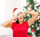 Surprised woman in santa helper hat — Stock Photo