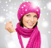 Woman in hat and muffler with big snowflake — Stock Photo