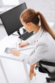 Businesswoman with notebook and calculator — Stock Photo