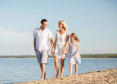 Happy family at the seaside — Stock Photo