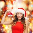 Stock Photo: Womin santhelper hat with jingle bells