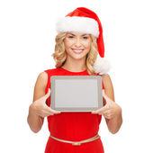 Tablet pc ile santa yardımcı şapkalı kadın — Stok fotoğraf