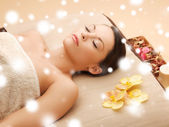 Woman in spa salon lying on the massage desk — Stock Photo