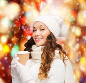 Woman in hat with takeaway tea or coffee cup — Stock Photo