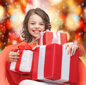 Happy child girl with gift boxes — Fotografia Stock