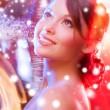 Woman in evening dress wearing diamond earrings — ストック写真