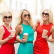 Women with takeaway coffee cups in the city — Stock Photo #33006133