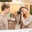 Couple taking photo picture in cafe — Stock Photo #33006599