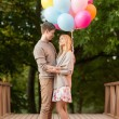 Couple with colorful balloons — Stock Photo #33007333