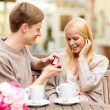 Stock Photo: Romantic mproposing to beautiful woman