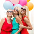 Stock Photo: Beautiful girls with colorful balloons in the city
