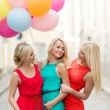 Beautiful girls with colorful balloons in the city — Stock Photo #33009075
