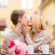 Romantic happy couple kissing in the cafe — Stock Photo #33009173