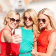 Beautiful girls taking picture in city — Stock Photo #33009447