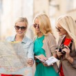 Beautiful women with tourist map in the city — Stock Photo #33009975