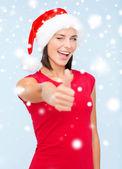 Woman in santa helper hat showing thumbs up — Zdjęcie stockowe