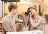 Couple taking photo picture in cafe — Stockfoto