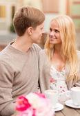 Romantic happy couple in the cafe — Stock Photo