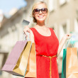 Beautiful woman with shopping bags in the ctiy — Stock Photo #33010129
