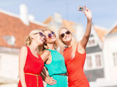 Beautiful girls taking picture in the city — Stock Photo