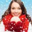 Woman in scarf and mittens with christmas ball — Stock Photo