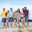 Group of friends having fun on the beach — ストック写真 #33073741