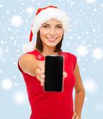 Woman in santa helper hat with smartphone — Stock Photo