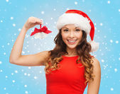 Woman in santa helper hat with jingle bells — Stock Photo