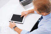 Businessman with tablet pc in office — Stock Photo