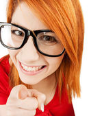 Woman in glasses pointing finger — Stock Photo