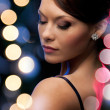 Woman in evening dress wearing diamond earrings — Stock Photo #33301387