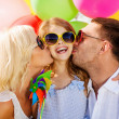 Family with colorful balloons — Stock Photo #33302971