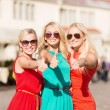 Three beautiful women in city — Stock Photo #33303229