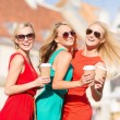 Women with takeaway coffee cups in the city — Stock Photo #33303293