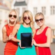 Beautiful tourist girls holding tablet pc — Stock Photo