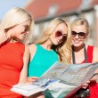 Stock Photo: Beautiful women with tourist map in the city